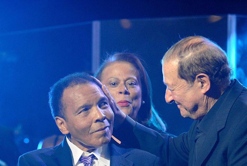 Boxing promoter Bob Arum greets an ailing Muhammad Ali.