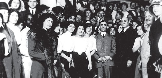 Across the Divide: Harris, left, and Blanck pose with workers at one of their garment factories