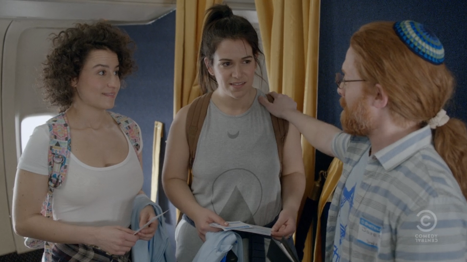 "Broad City's Abbi and Ilana are welcomed to ""Birthmark"" by Jared (Jewish guest star Seth Green), who sports a blue-and-white kippah and an absurd long red ponytail."