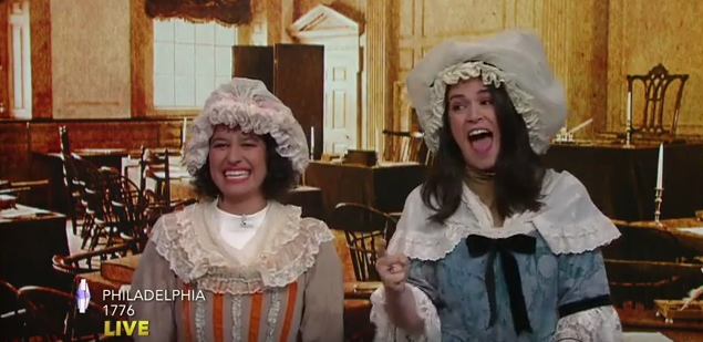 "Ilana Glazer (left) and Abbi Jacobson as colonial women on ""The Late Show with Stephen Colbert"""