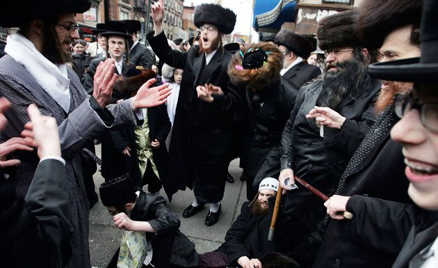 Speaking Yiddish: Hasidic Jews celebrate Purim in Brooklyn in 2007.