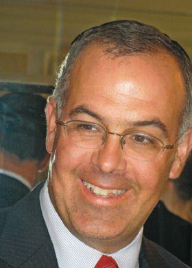 Jews of Wall Street: Columnist David Brooks speaks at the holiday event.