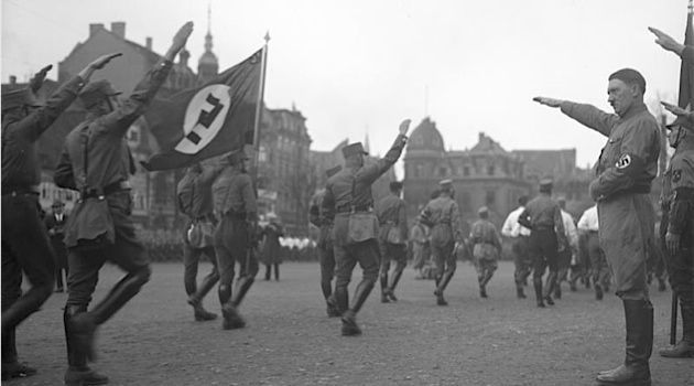 Early Supporters: Adolf Hitler attending a march of the Sturmabteilung, the paramilitary wing of the Nazi party, in 1932.