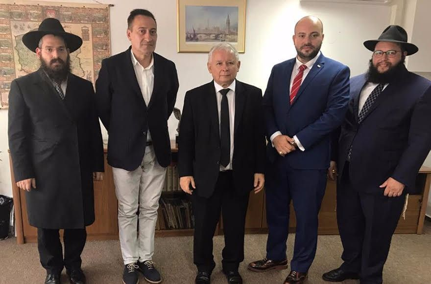 Jarosław Kaczyński (center), Poland's hard line nationalist leader, met on August 17 with (from left to right) Chabad's representative in Cracow, Rabbi Rabbi Eliezer Gurary; Artur Hoffman the executive director of the Jewish cultural group TSKZ; Jonny Daniels, an Israeli-British public relations consultant, and Rabbi Shalom DovBer Stambler, Chabad's representative in Warsaw.