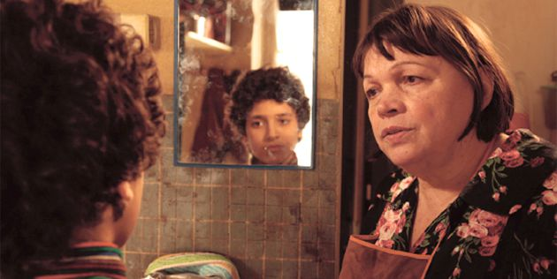 The Play Before Us: Momo (Julien Soster), in mirror, is devoted to Madame Rosa (Myriam Boyer), an Auschwitz survivor and ex-prostitute who is terminally ill.