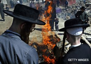 NO TRACE: Ultra Orthodox burn bread before the start of Passover at a ceremony in Jerusalem.