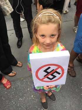 Cherie Zucker's 5-year old at an anti-Trump protest on 5th Avenue after the violence in Charlottesville, Virginia.
