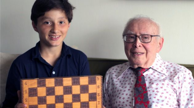 Check Mates: Zachary Targoff holds chessboard that belonged to the father of Herman Bomze before he was killed in the Holocaust.
