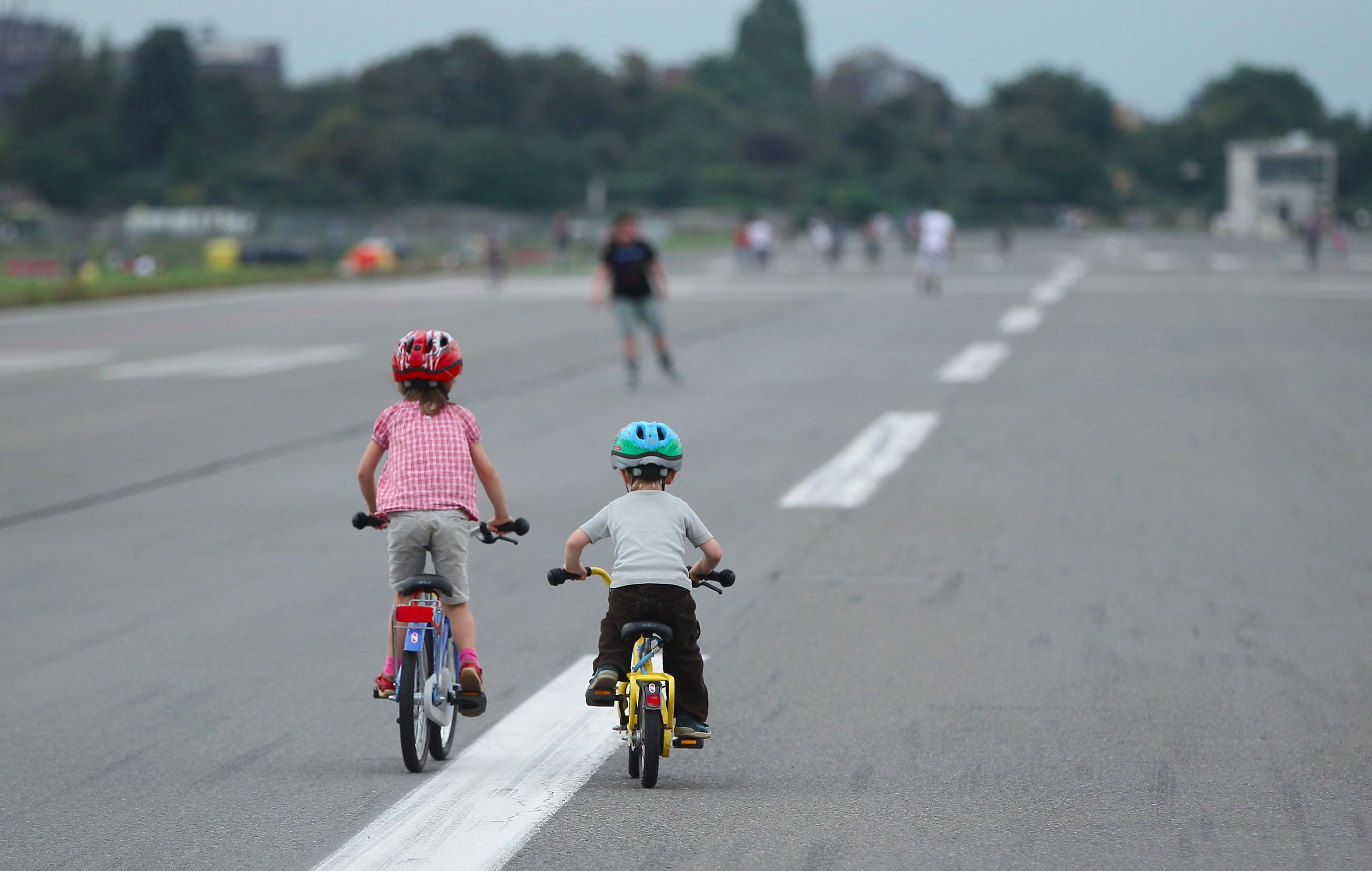 Children biking in the road in Berlin.