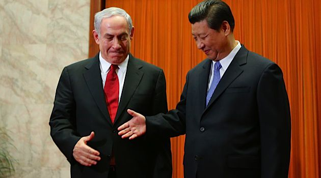 Handshake: President Xi and Prime Minister Netanyahu meet in China this week.