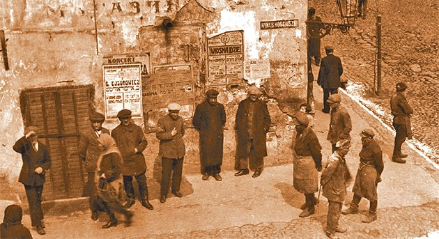 Unemployed Workers: Alter Kacyzne, the Forward?s renowned photographer, captioned this image from Bialystok circa 1920, ?Standing on the corner, looking for a little work.?