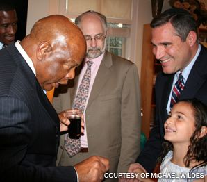 MARCHING ON: Georgia Rep. John Lewis spoke with the Orthodox mayor of Englewood, N.J., Michael Wildes, right, and his daughter.