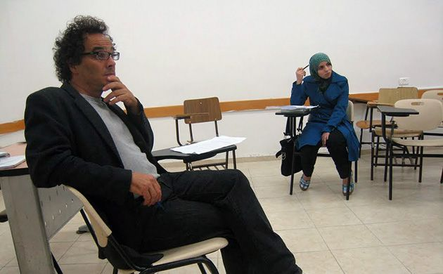 Class in Session: Anthony David, left, an American historian and writer, teaches a first-year seminar. Student Duaa Faisal Ghatesheh, right, is from the al-Fawar refugee camp near Hebron.