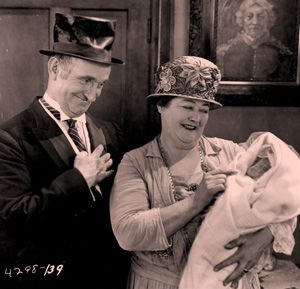 ?The Cohens and the Kellys?: Vaudeville comedian Charlie Murray admires a newborn baby in the film ?The Cohens and the Kellys?, a tale of friendly rivalry between Jewish and Irish neighbours.
