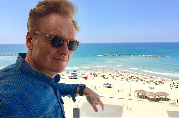 Conan O'Brien enjoys the Tel Aviv beach while filming a special for his TBS show.