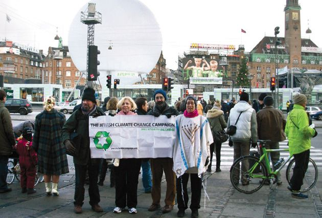 Making a Statement: Mirele Goldsmith, in tallit, and colleagues prepare for a rally on climate action in front of Copenhagen?s town square.