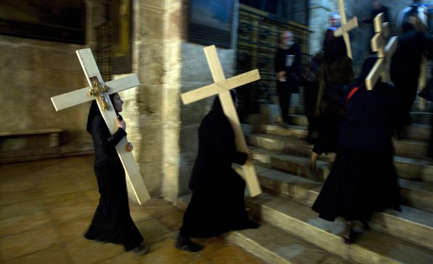 Procession: Christian Orthodox worshippers carry wooden crosses in the Church of the Holy Sepulcre. A question about the site is featured on a new Facebook trivia application.