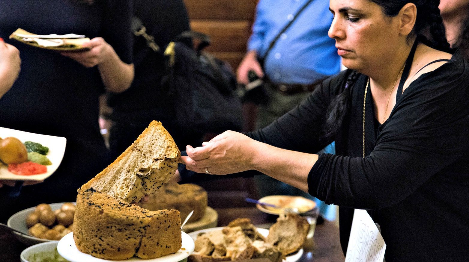 Einat Admony slices the Yemenite Shabbat bread called kubaneh.