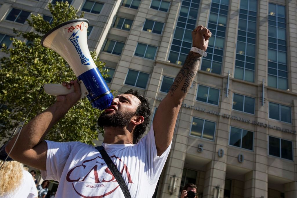 A demonstrator leads a chant outside of the U.S. Immigration and Customs Enforcement building during a demonstration in response to the Trump Administration's announcement that it would end the Deferred Action for Childhood Arrivals (DACA) program.
