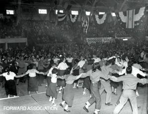 In America: Members of the Habonim labor Zionist youth group in Detroit dance the hora at a celebration of Israel?s third year of independence, in 1951.