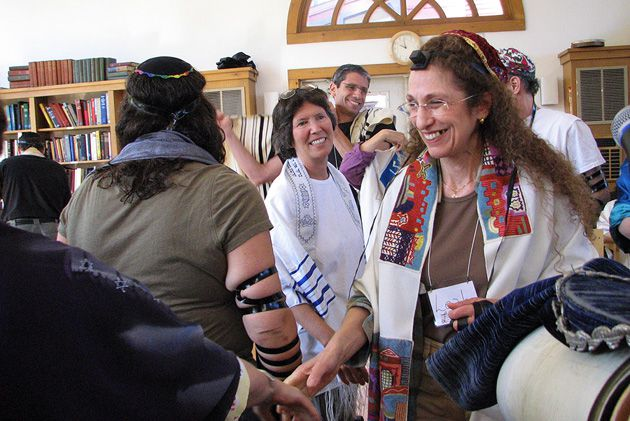 After the Reading: Leah Frey-Rabin of Frankfurt, Germany, center, reaches out to others who congratulate her on a beautiful reading of the Torah at a weekday morning service.