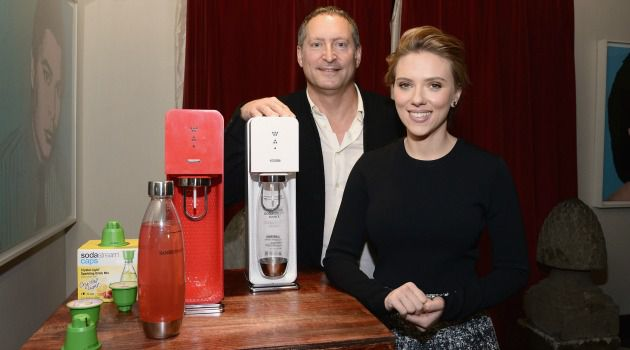Soda, Scarlett and Me: Daniel Birnbaum poses with SodaStream home beverage machines ? and superstar spokesperson Scarlett Johansson.