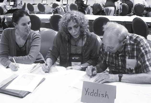 The Past Speaks: Volunteer translator Sol Krongelb of Katonah, N.Y., helps Maris Bredt (center) of Studio City, Calif., with Yiddish notations she found on the backs of old family photos. Jennifer Starrels (left) of Philadelphia waits for assistance with copies of Yiddish immigration records.