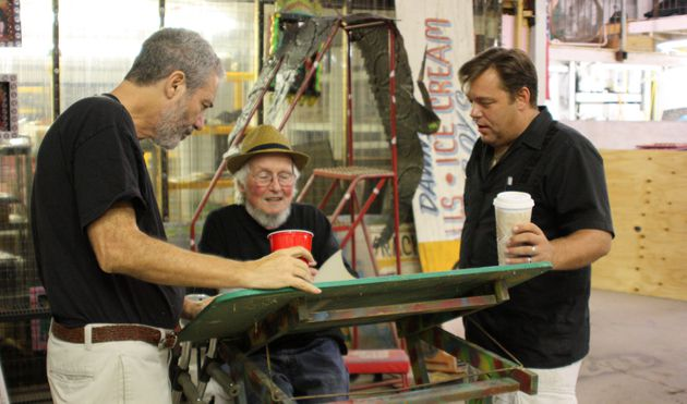 Poets At Dr. Bob?s Compound in New Orleans: David Meltzer (center), flanked by Roger Kamenetz (left) and David Brink gather to compose at the easel.