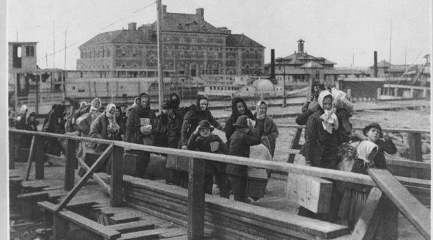 Hard Landing: Immigrants arrive at Ellis Island at the turn of the last century.