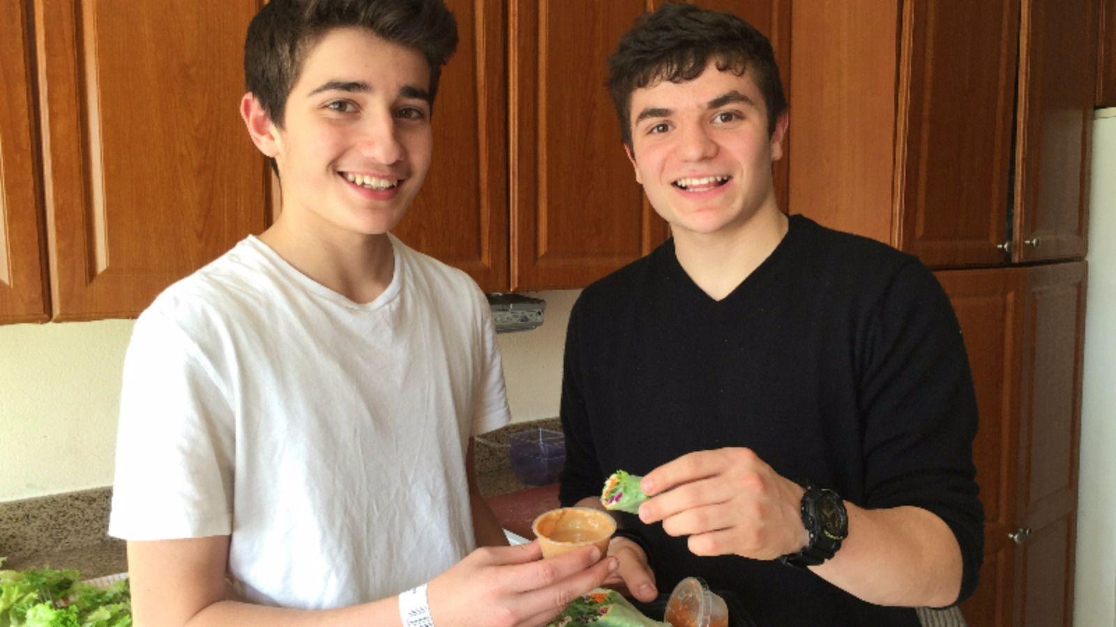 Brothers Gabriel (right) and Raphael Shpitalnik make their kosher Angel Rolls after school twice a week.