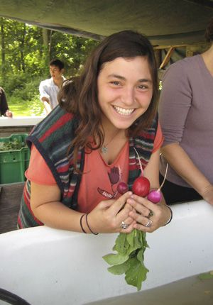 Bountiful: JFS participant Michal Gersman cleans radishes after harvesting them at Common Ground Farm in Beacon, N.Y., during a field trip.