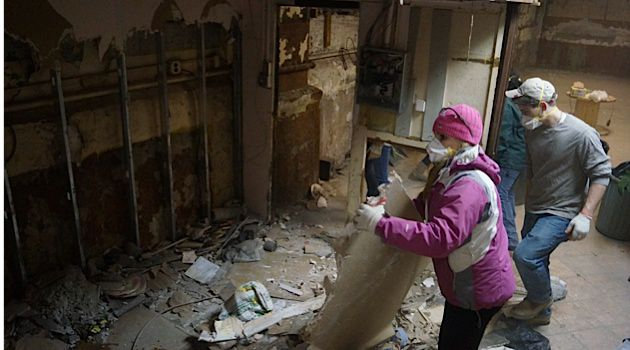 Interfaith Help: Christian volunteers pitch in to help clear debris from the badly damaged Russian American Jewish Experience in Brighton Beach, Brooklyn.
