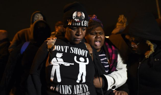 Shocked: Residents of Ferguson react to the news that a police officer will not be indicted in the death of Michael Brown.