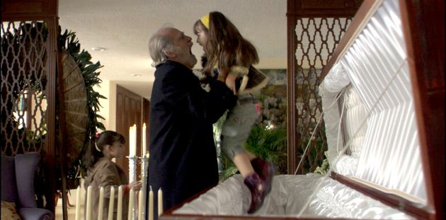 Casket: José (Fernando Luján) lifts up one of his granddaughters, who had been playing in his ex- wife?s empty casket.