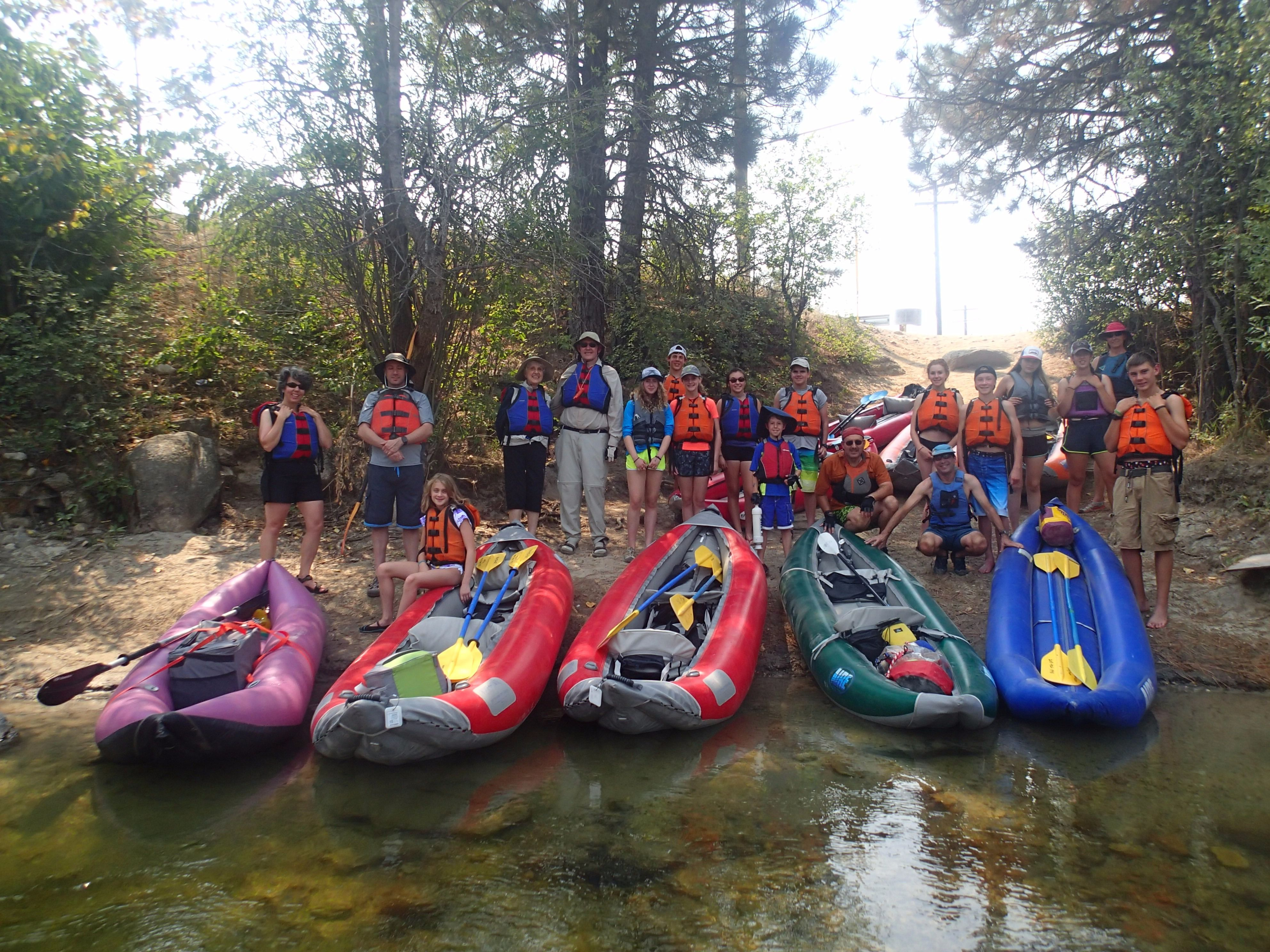 River Rabbi: Rabbi Dan Fink (kneeling in front of green boat) leads members of Ahavath Beth Israel in Boise on a rafting trip on the South Fork of the Payette River in August 2015.