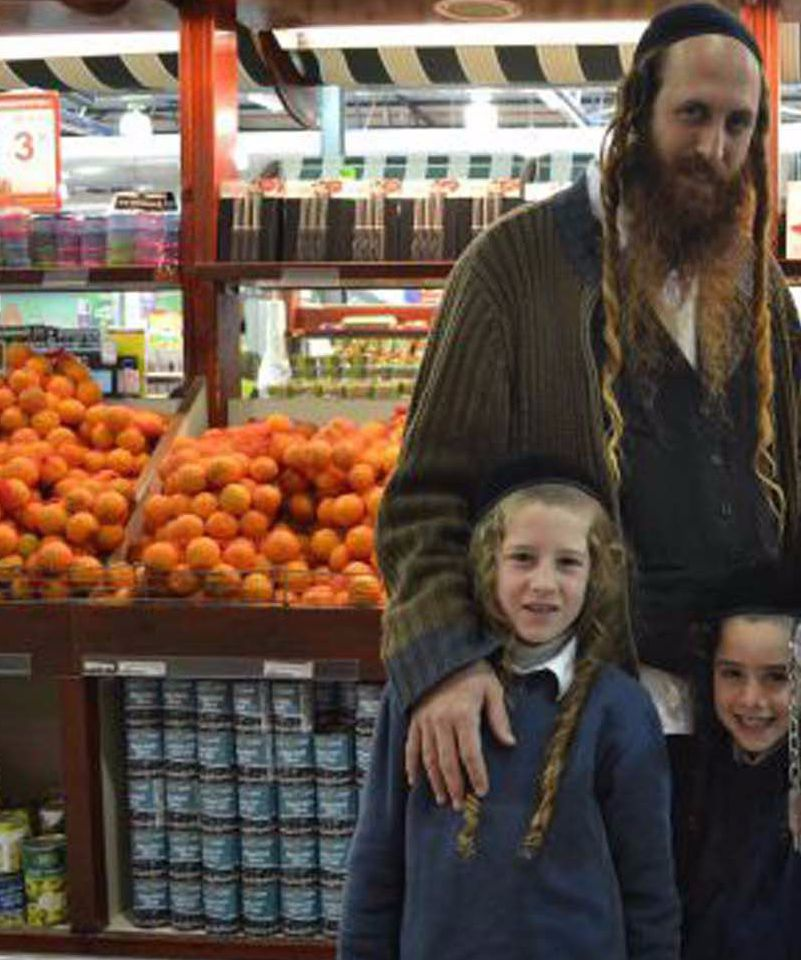 Staying Fresh:Dror Moshe Cassouto shops for produce from Gaza and Jordan with his three sons at Rami Levy, a Jerusalem market.