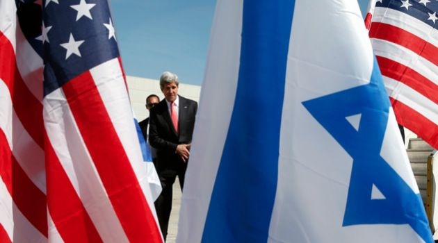 In Between: Secretary of State John Kerry arrives in Israel as part of his shuttle diplomacy in the Israeli-Palestinian peace negotiations.