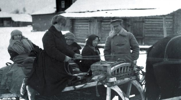 Outside Moscow: The writers Bessie Beatty (left) and Helen Auger with Mrs. Kalinin (behind the driver) and Rafael Rubinstein (far right) on a sled. As titular head of Soviet Russia, Kalinin needed financial guidance and Rubenstein was Kalinin?s tax expert.