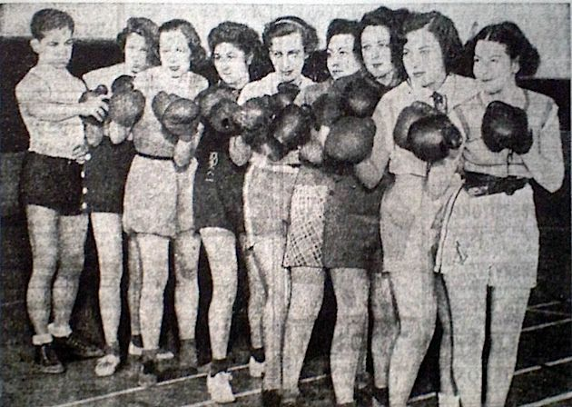Wanna Fight? [75 years ago] These girls from Westchester Collegiate Center in White Plains, N.Y., have formed a boxing team under the tutelage of Milton Greenberg (left). They are looking for fights with boys.