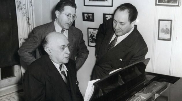 Rehearsals: Tuning up for the Festival of Jewish Arts held at Carnegie Hall, composer and pianist Jacob Weinberg with conductor Isidor Freed (back), and basso Sidor Belarsky (right).