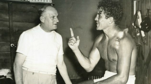 Tête-à-tête: Powerful boxing promoter, Coney Island born Mike (Strauss) Jacobs shown here in a conversation with boxer Max Baer. Jacobs also organized Joe Louis?s exclusive boxing promotion deal at a time when African-American boxers were held back by discriminatory barriers