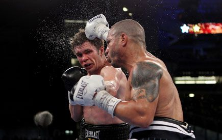 Jewish boxer Yuri Foreman takes a punch on the way to his tough loss to Miguel Cotto at Yankee Stadim on Saturday.