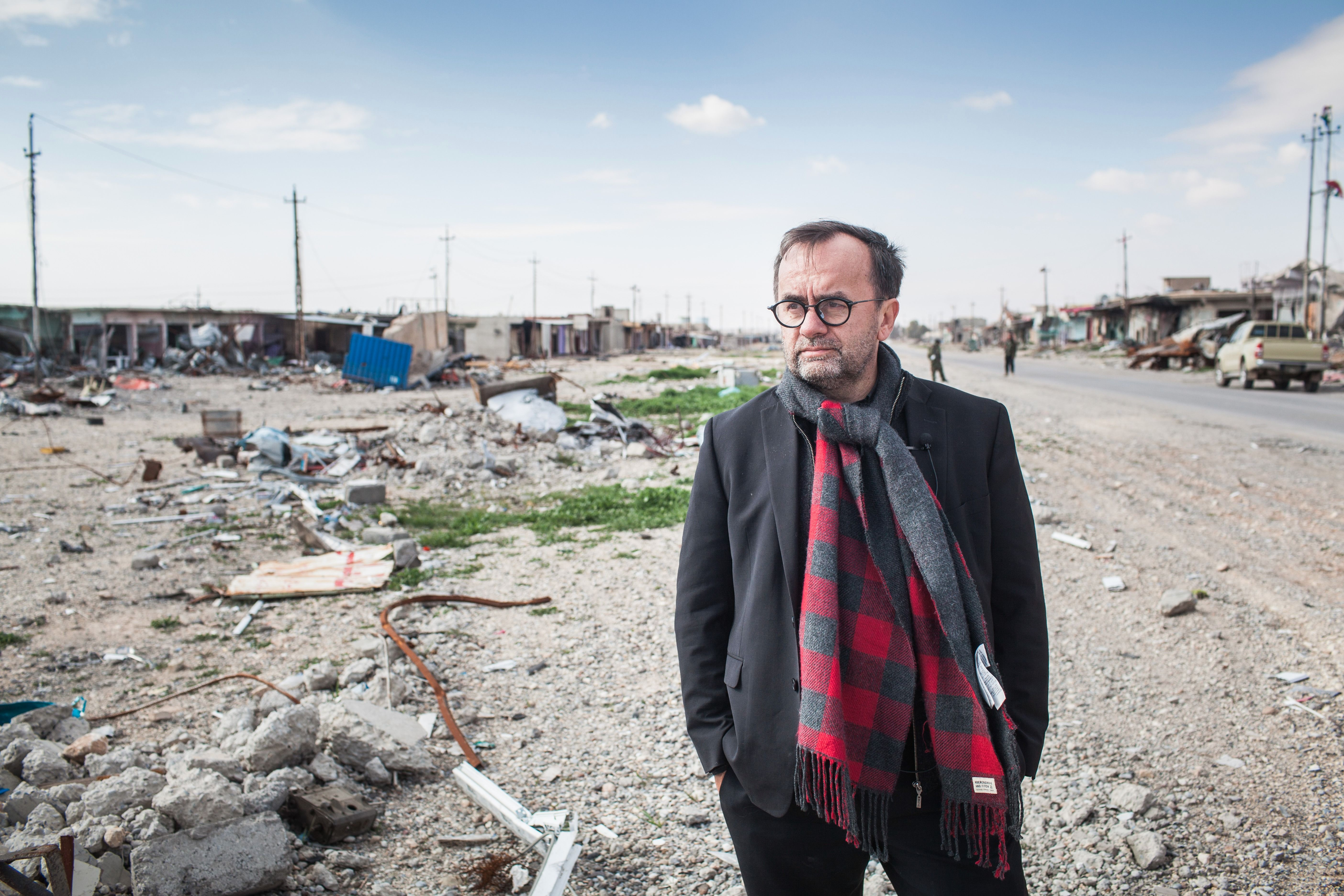 Father Patrick Desbois visits site of ISIS atrocities in Sinjar.