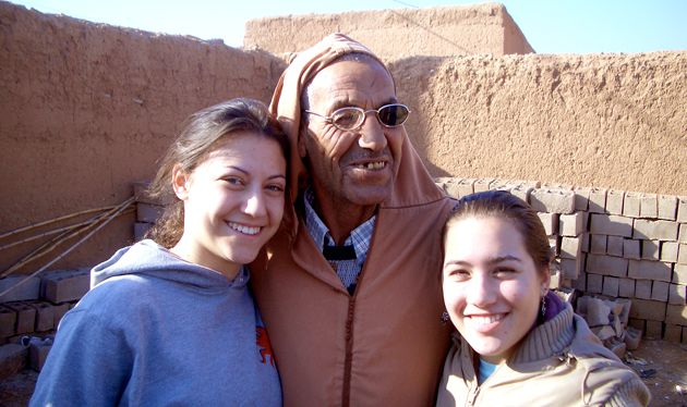 Globe-Trotters: In many of the gap year programs, students travel extensively to learn about Judaism throughout the world. Above, Bukspan (left) and a fellow gap year student pose with a Muslim man from the Berber village of Arazan during a visit to Morocco.