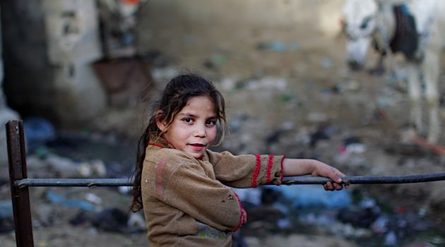 Gazan Poverty: A girl poses in the poverty-stricken neighborhood of Beit Lahia in northern Gaza.