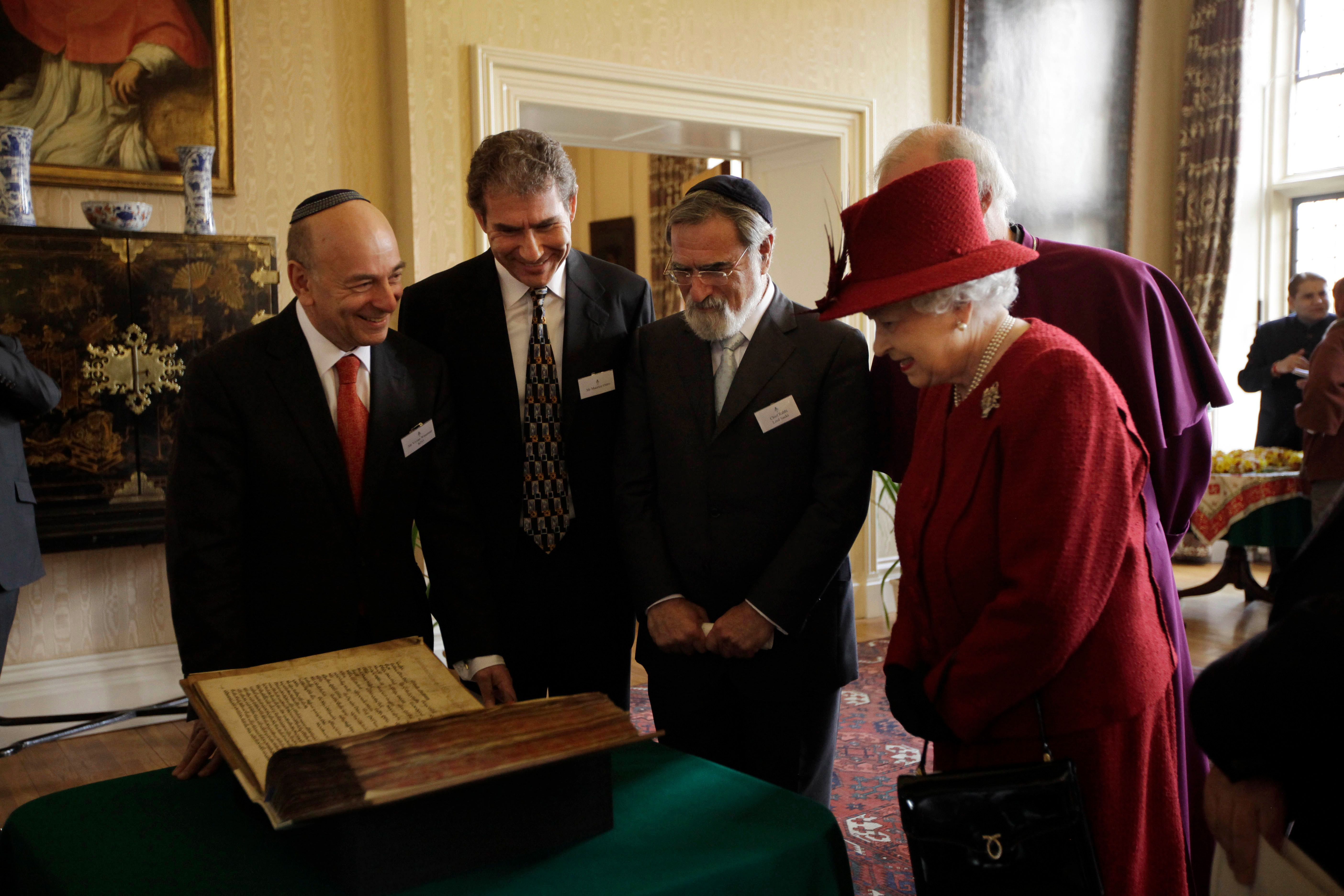 The Royal Treatment: Queen Elizabeth II looks over the Codex Valmadonna I book, from Lunzer's collection, at Lambeth Palace in February 2012, as Jewish communal officials look on.