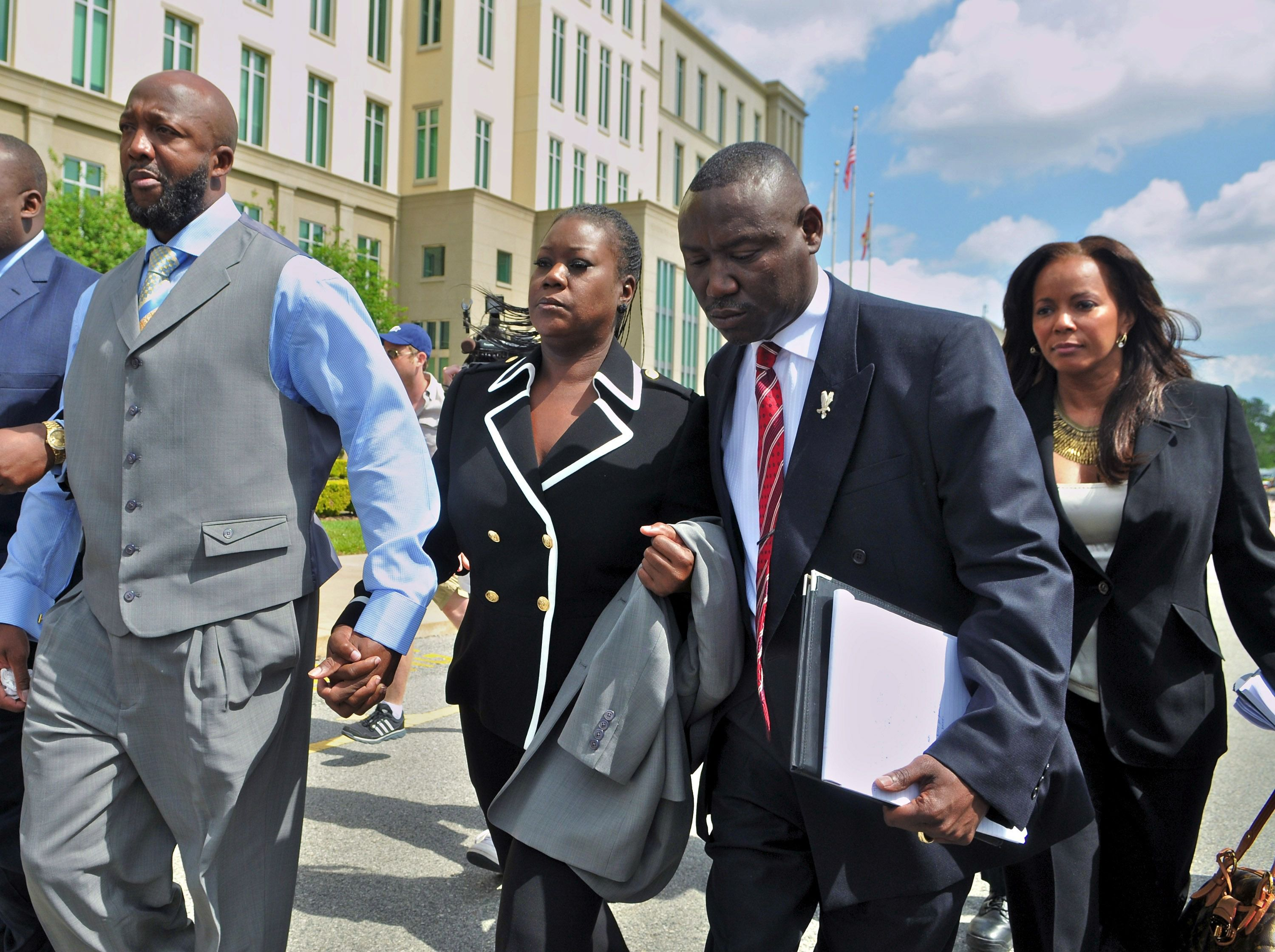 Tracy Martin and Sybrina Fulton, parents of Trayvon Martin, their attorney Benjamin Crump and attorney Natalie Jackson leave Seminole County courthouse without talking to reporters after the bond hearing for George Zimmerman.