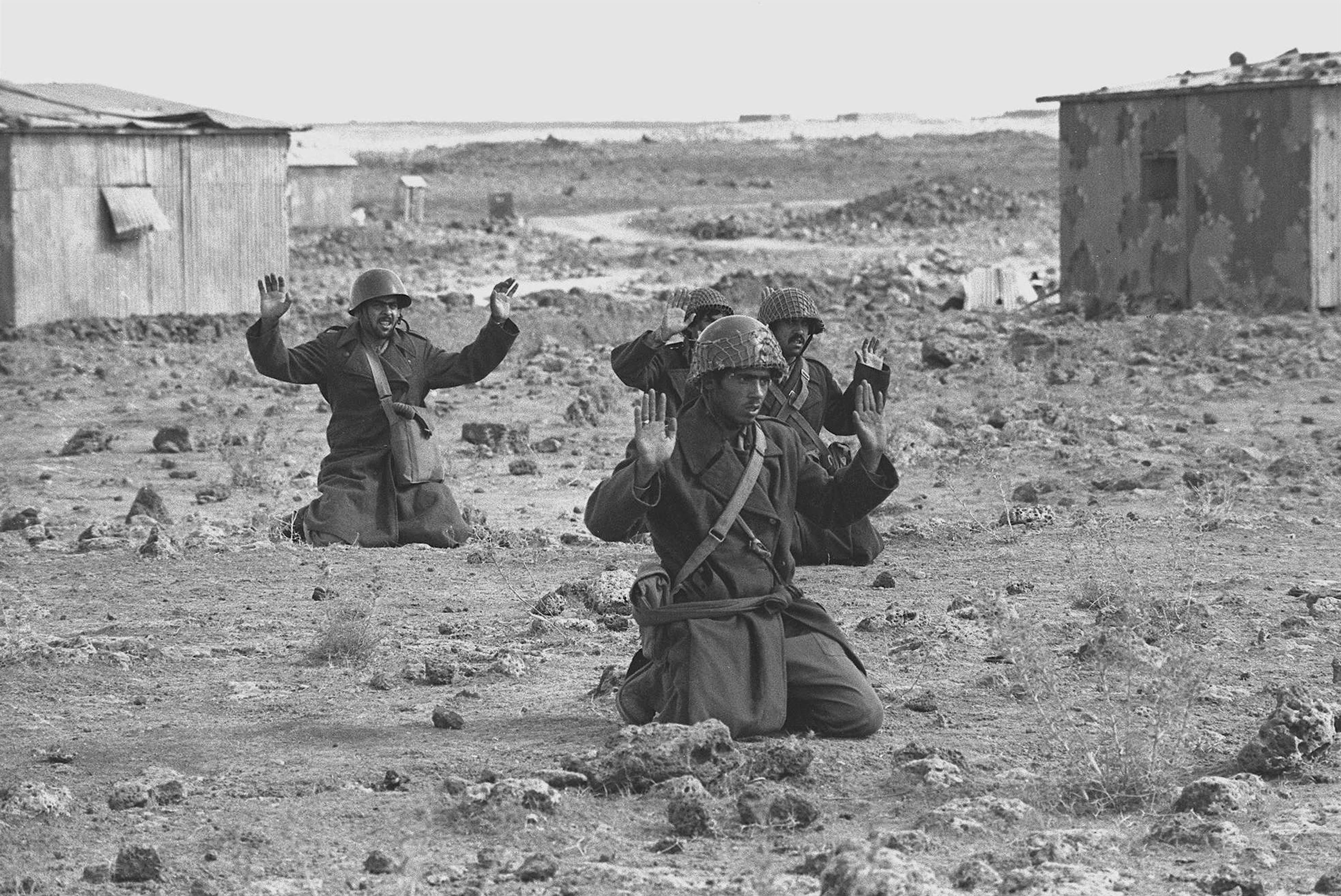 Syrian soldiers raise their hands in surrender October 10, 1973 on the Golan Heights, five days into the Yom Kippur War.