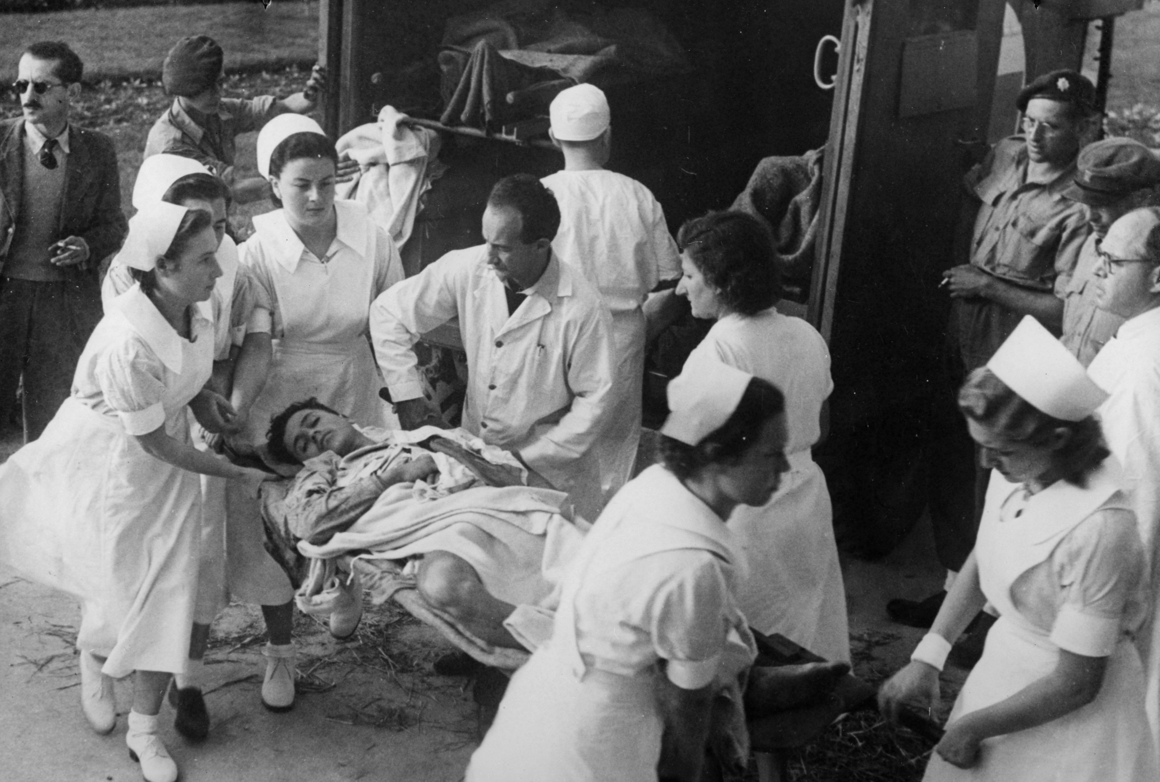 Doctors and nurses tend to the wounded
