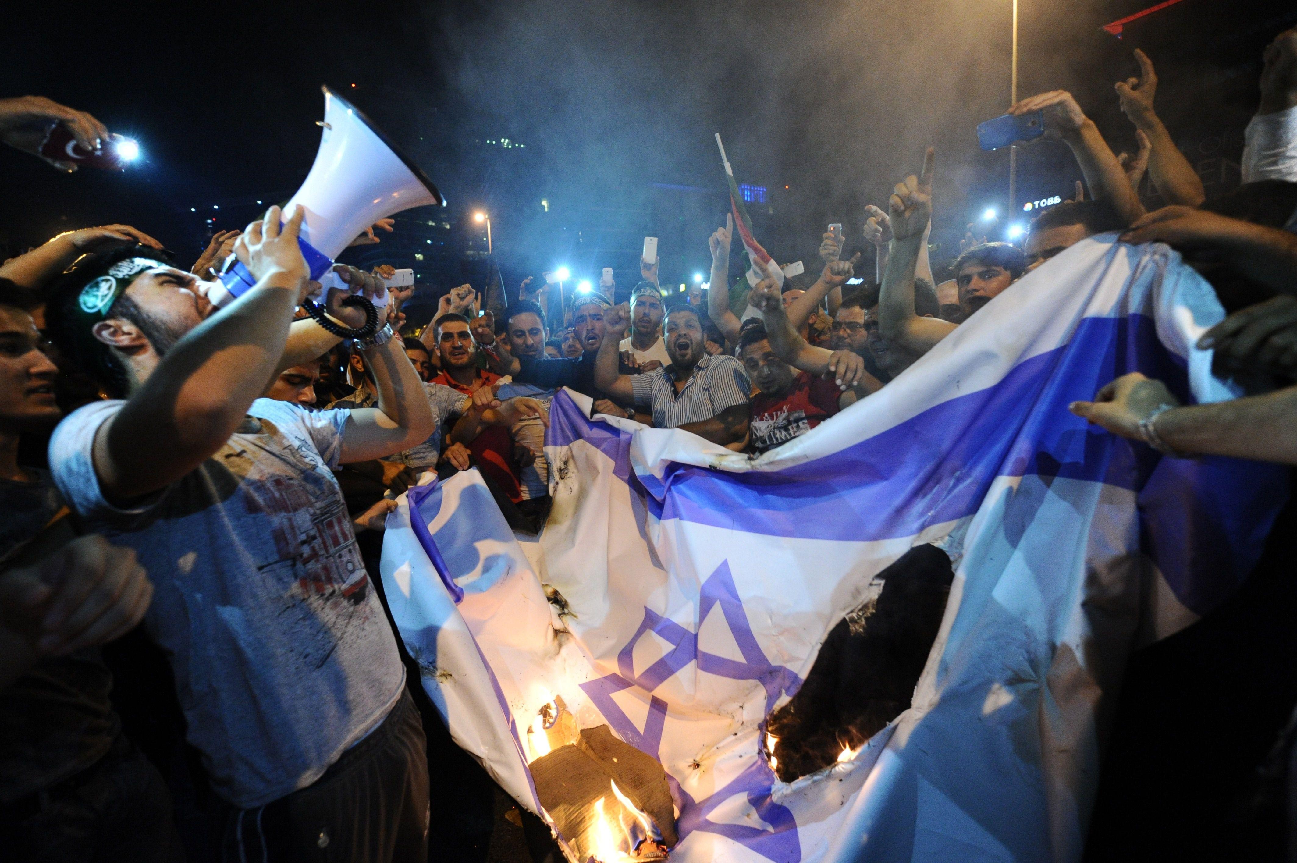 Turkish protestors burn Israeli flag during demonstration against the Gaza War in 2014.